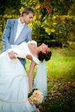 Portrait of kissing newlyweds Stock Photo