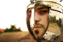 Portrait of a knight. With golden helmet Stock Image