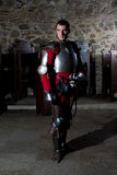 Portrait of Knight in Armor Standing in Old Monastery. Full Length Portrait of Knight in Armor Standing in Old Monastery Stock Photos
