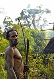 The Portrait Korowai hunter with arrow and bow. Royalty Free Stock Image