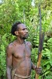 The Portrait Korowai hunter with arrow and bow. Royalty Free Stock Photography