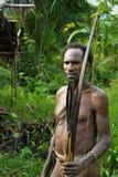 The Portrait Korowai hunter with arrow and bow. Royalty Free Stock Photos