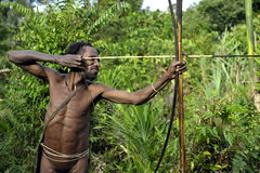 The Portrait Korowai hunter with arrow and bow. Royalty Free Stock Image