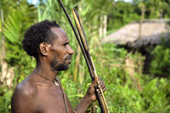 The Portrait Korowai hunter with arrow and bow. Stock Photography