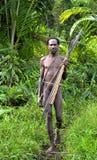 The Portrait Korowai hunter with arrow and bow. Stock Photo