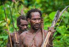 The Portrait Korowai man hunter with arrow and bow. Tribe of Korowai Kombai , Kolufo. stock photography