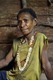The Portrait Korowai woman in the wood house. Royalty Free Stock Images