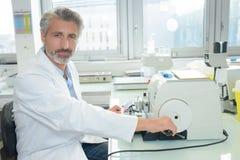 Portrait laboratory technician operating equipment. Portrait of laboratory technician operating equipment Stock Image