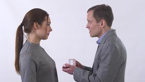 Portrait of lady does not accept marriage proposal and close little box, proposed to her by a man isolated on white stock footage