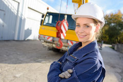 Portrait lady in front crane Royalty Free Stock Photography
