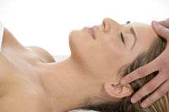Portrait of lady getting head massage Royalty Free Stock Images