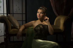 Portrait of the lady in a luxurious boudoir Royalty Free Stock Image