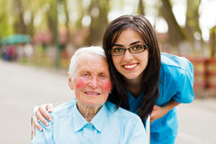 Portrait of a Lady and Nurse Stock Photography