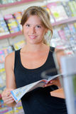 Portrait lady reading magazine Stock Images