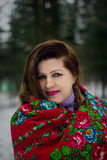Portrait of lady in red scarf. In winter park Stock Image