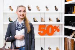 Portrait of lady in shop with 50% sale Royalty Free Stock Photo