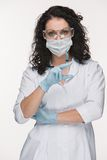 Portrait of lady surgeon showing syringe over Royalty Free Stock Image