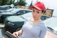 Portrait lady in vehicle yard. Portrait of lady in vehicle yard royalty free stock photos