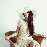 portrait of a lady in a vintage chair Royalty Free Stock Photography