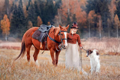 Portrait of Lady XIX Century. Portrait of LadyXIX Century  with horse and russian borzoy dogs Stock Images