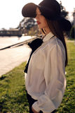 Portrait of ladylike woman in elegant shirt and felt hat Royalty Free Stock Photos