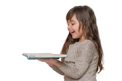 Portrait of laghing little girl holding a book Stock Image