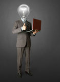 Portrait of lamp-head businessman with laptop. Full length portrait of lamp-head businessman with laptop, showing welldone Royalty Free Stock Photography