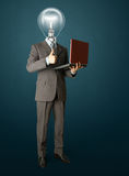 Portrait of lamp-head businessman with laptop. Full length portrait of lamp-head businessman with laptop, showing welldone Royalty Free Stock Images