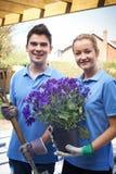 Portrait Of Landscape Gardeners Working In Garden Royalty Free Stock Photography