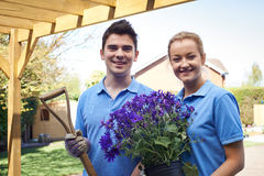 Portrait Of Landscape Gardeners Working In Garden. Landscape Gardeners Working In Garden Stock Photography
