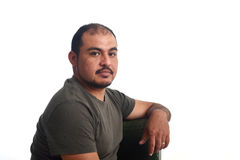 Portrait of a latin man on white. Background stock images
