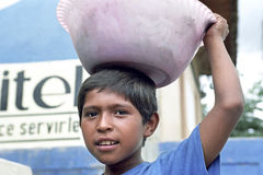 Portrait of Latino boy with bowl on head Stock Image