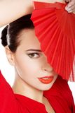 Portrait of a latino dancer wearing red dress Stock Photos