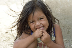Portrait of Latino girl brushing her teeth, Nicaragua. Nicaragua, department of Nueva Segovia, Ocotal city: Close-up of child, that her baby teeth is to brush stock photography
