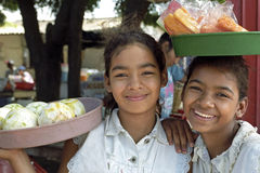 Portrait of Latino girls selling fruits Royalty Free Stock Images