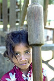 Portrait Latino, Indian girl with rice pestle. Nicaragua, San Andres village: close of Nicaraguan, Miskito indian, child during pounding grain with pestle, but Stock Images