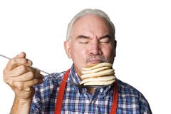 Portrait of an Latino man smelling stack of pancak Royalty Free Stock Photo