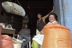 Portrait of Latino shopkeeper in shop doorway Stock Photo