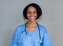 Portrait of laughing african american nurse royalty free stock photos