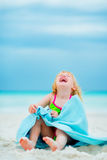 Portrait of laughing baby girl in towel Royalty Free Stock Image
