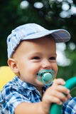 Portrait of a laughing baby with pacifier Royalty Free Stock Photos