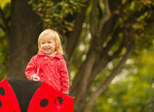 Portrait of laughing baby with red umbrella Stock Photos
