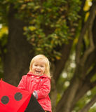 Portrait of laughing baby with red umbrella Stock Images