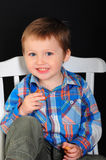 Portrait of a laughing blond boy with blue eyes royalty free stock photography