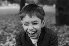 Portrait of a laughing boy. Black and white portrait of a laughing boy Stock Photography