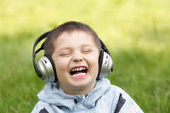 Portrait of laughing boy in headphones Stock Image