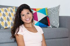 Portrait of laughing caucasian woman at home Stock Photo
