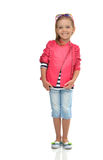 A portrait of laughing fashion little girl full body standing in Royalty Free Stock Images