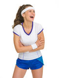 Portrait of laughing female tennis player Stock Photos