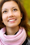 Portrait of laughing girl. Young beautiful woman looks upwards and cheerfully laughs Stock Photography